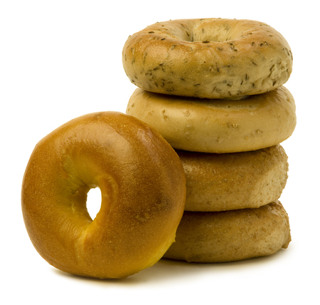 bagel: Stack of four bagels with one leaning on the side against white background. Stock Photo