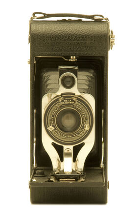 bellows: Vintage folding bellows film camera against white background.