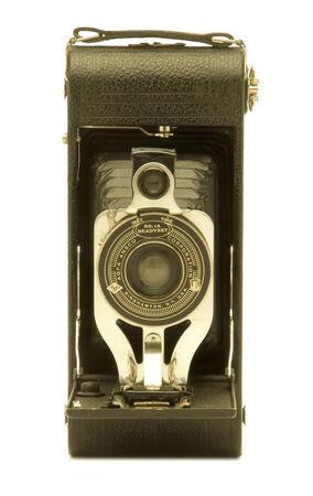 folding camera: Vintage folding bellows film camera against white background.