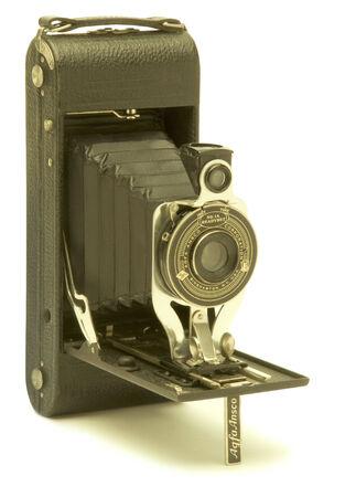 folding camera: Vintage folding bellows film camera against white background Stock Photo