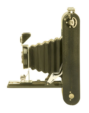 folding camera: Vintage folding bellows film camera in profile against white background.