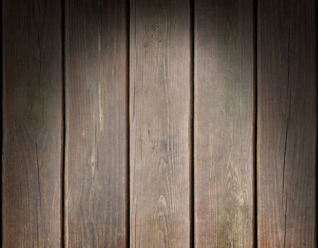 Weathered wooden plank background texture lit dramatically from above photo