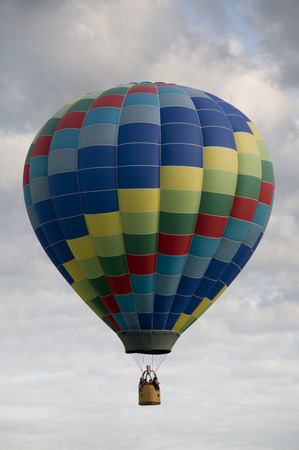 flying float: Colorful Hot Air Balloon Among the Clouds