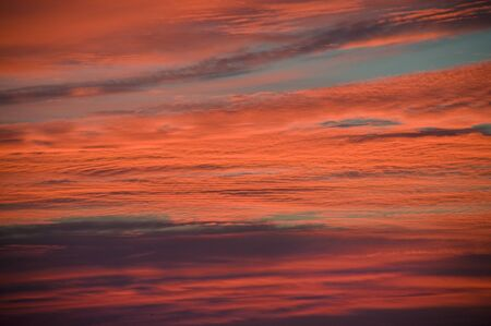 Pink and orange clouds at sunrise or sunset