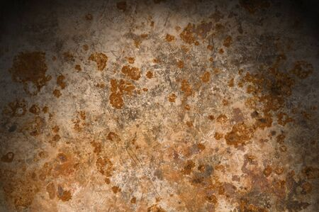 Metallic background with rusty corrosion lit from above