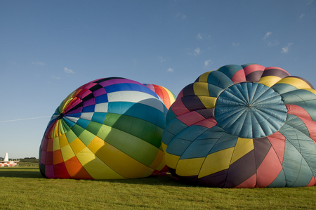 hotair: Two hot-air balloons inflating on the ground