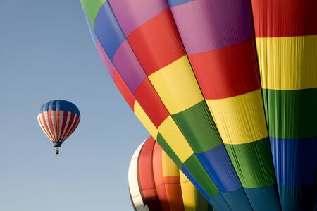 hot air balloons festival: Colorful hot air balloons launching against a blue sky Stock Photo