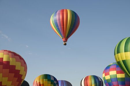 launch vehicle: A single hot-air balloon floating above others at a balloon festival Stock Photo