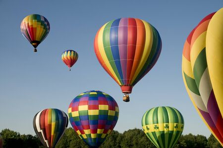 ballooning: Various hot-air balloons with colorful envelopes ascending or launching at a ballooning festival