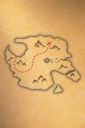 黄色い紙の上の島の宝の地図を骨董品見る