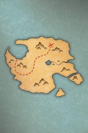 パピルスのような紙の上の島の宝の地図を骨董品見る 写真素材
