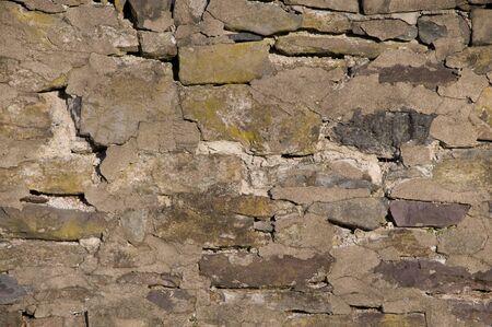Cracked dilapidated masonry wall Stock Photo