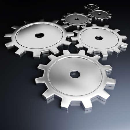 Metallic cog-wheels on a dark background  Фото со стока