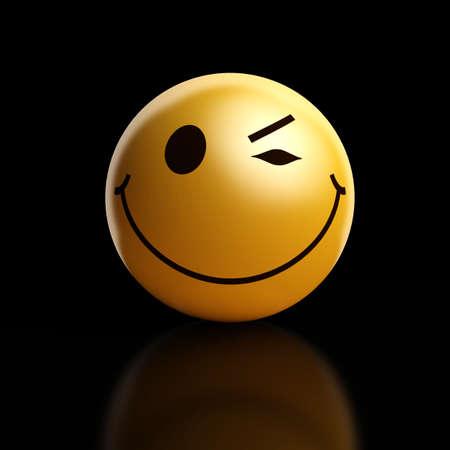 A winking smiley on a dark background Standard-Bild