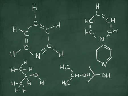 chemical formulas on green chalkboard Фото со стока