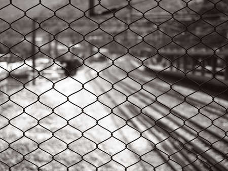 metal net and railway station, in black and white Stock Photo