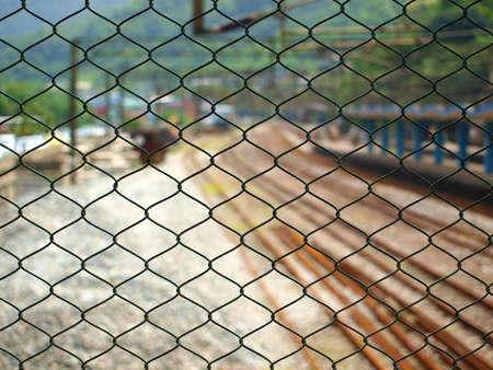 metal net and railway station
