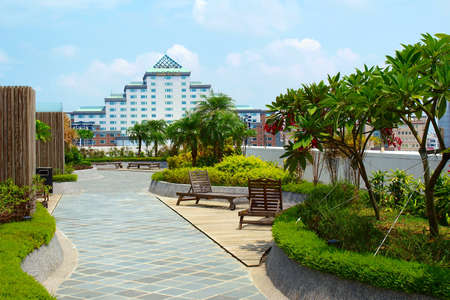 Tropical garden and Tainan City Hall in Taiwan Stock Photo