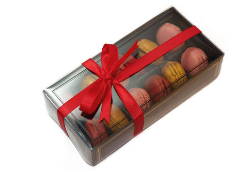 Macarons in gift box with red ribbon