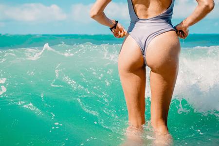 Slim luxury girl in a bikini. Perfect tanned body, perfect figure Banco de Imagens - 80086530