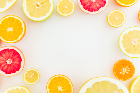 Frame made of citrus fruits on white background. Flat lay, top view. Fruits background