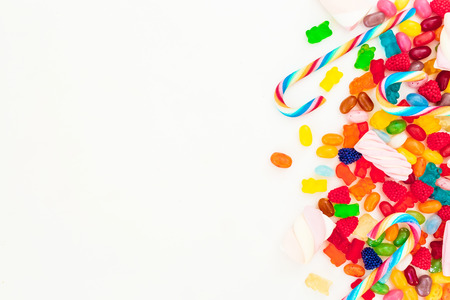 kids birthday party: Mixed colorful candies isolated on white background. Flat lay, top view Stock Photo