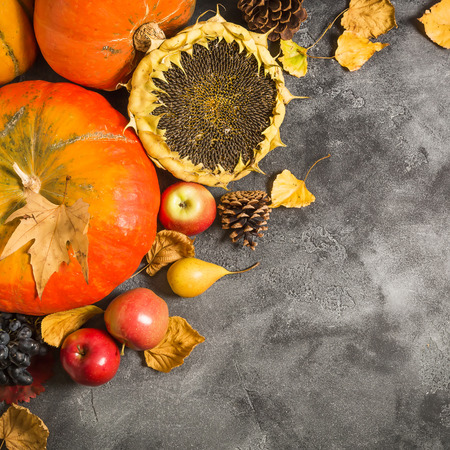Autumn background with fallen leaves, fruits and vegetables on a dark table. Thanksgiving day concept, Flat lay, top view Stock Photo