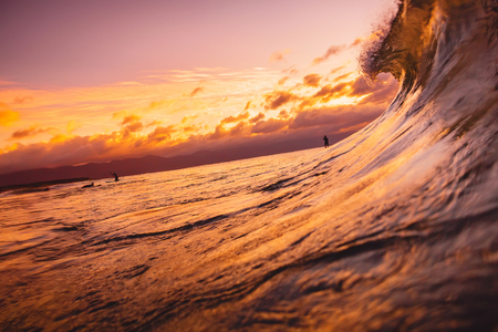 amanecer: Ocean wave breaking down at sunset or sunrise time. Wave and with warm sunset or sunrise colors Foto de archivo