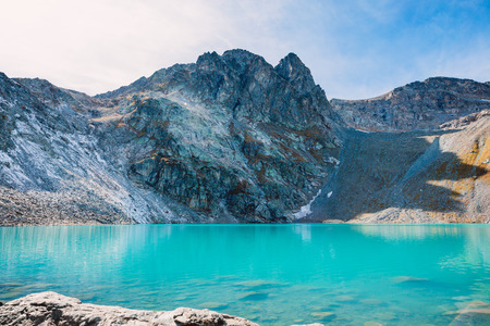 Mountain lake with turquoise water and rocks Stock Photo