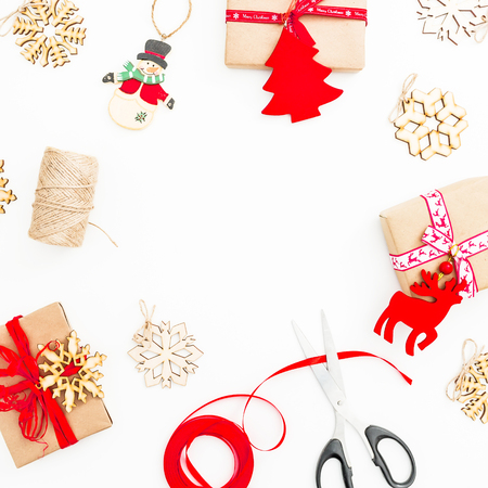 Christmas composition. Frame made of christmas gifts, twine, toys on white background. Flat lay, top view, copy space
