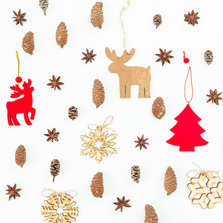 Christmas decoration, snowflakes and pine cones on white background. Flat lay, top view. Holiday concept.