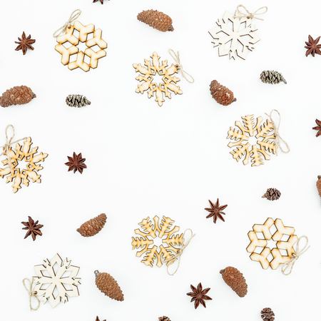 Christmas round composition of a wooden decoration, pine cones and anise on a white background. Flat lay, top view Stock Photo