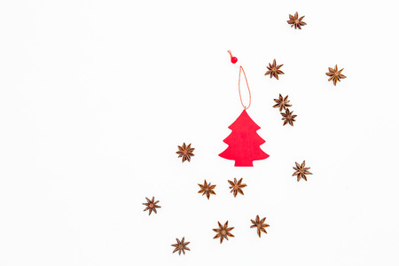 Christmas red decoration and anise stars on white background. Flat lay, top view. Christmas or New year concept