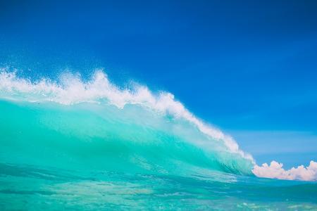 sun energy: Blue ocean wave at tropical beach. Clear wave in tropics and blue sky Stock Photo