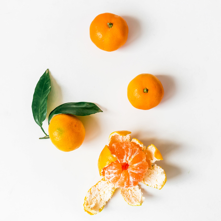 Fresh citrus clementine on white background. Flat lay. Top view