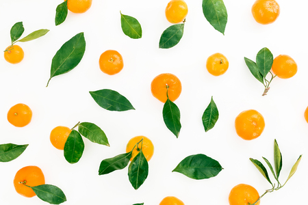 Pattern of fresh citrus with leaves on white background. Flat lay. Top view