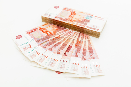 Russian 5000 rubles banknotes on white. Flat lay, top view Stock Photo