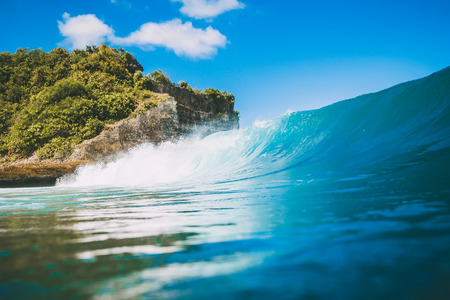 Blue crashing wave in the ocean, swell for surfing. Crystal wave in Bali Stock Photo