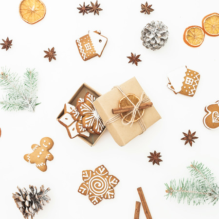 Christmas gingerbread cookies, gift box, fir branches and anise on white background. Flat lay. top view. New year holidays Stock Photo