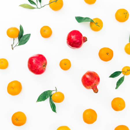 Citrus fruit and red garnet isolated on white background. Flat lay. Top view Foto de archivo