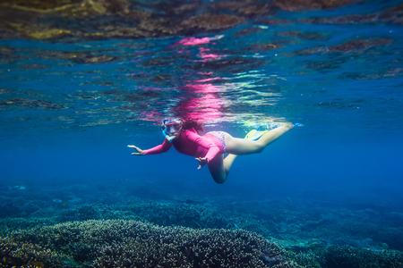 Underwater swimming in tropical ocean.