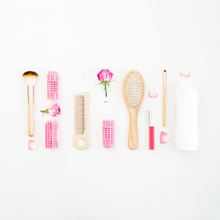 Hair styling concept with tools and shampoo on white background. Beauty composition. Flat lay, top view Foto de archivo