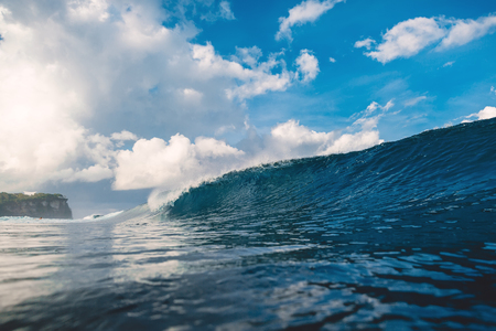 Perfect big breaking barrel wave in ocean and clouds Stock Photo