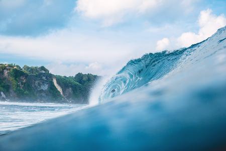 Perfect big breaking barrel wave in ocean