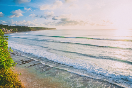 Blue waves for surfing at Bali and tropical beach. Ocean wave in Indonesia Stock Photo