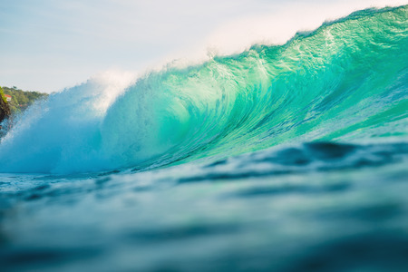 Big wave for surfing in the ocean. Breaking turquoise wave in Bali