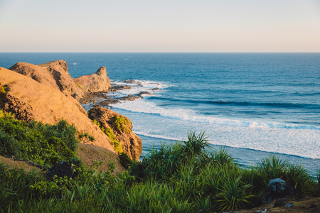 Tropical coast and waves for surfing in ocean