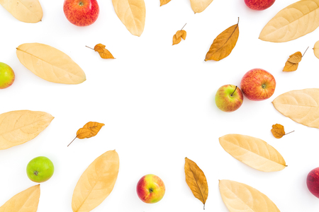 Thanksgiving composition. Frame of autumn dried leaves and apple fruits on white background. Flat lay, top view, copy space Stock Photo