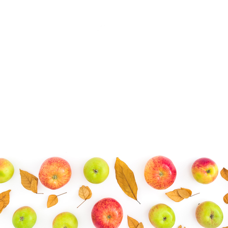 Frame of autumn dried leaves and apples on white background. Flat lay, top view. Thanksgiving day