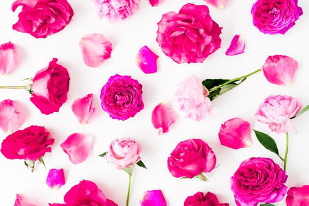Pink roses, petals and peonies on white background. Flat lay, Top view. Flowers texture.
